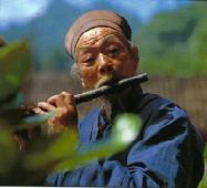 Taoist playing the flute